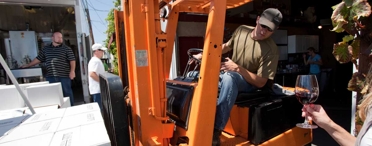 Ryan Carr on a forklift at Carr Winery in Santa Barbara near the Funk Zone